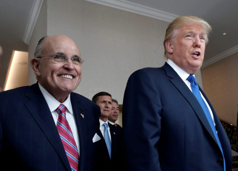 FILE PHOTO: Donald Trump walks with former New York City Mayor Rudolph Giuliani through the new Trump International Hotel in Washington